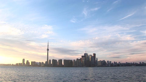 The Toronto skyline is lovely against a pastel, watercolor sky Footage