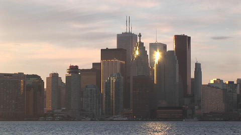 A lovely sunset picture of the Toronto skyline with sunlight reflecting off some of the buildings Footage