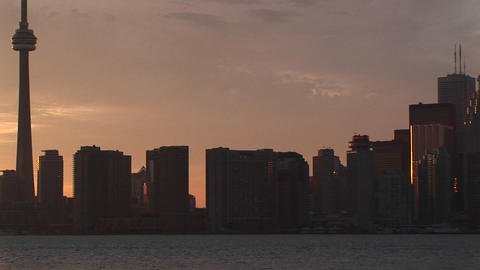 The camera pans the skyline of Toronto and ends with the CN-Tower and a pastel sky Footage