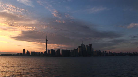 A spectacular golden-hour sky is the backdrop to this waterfront view of Toronto's skyline Footage