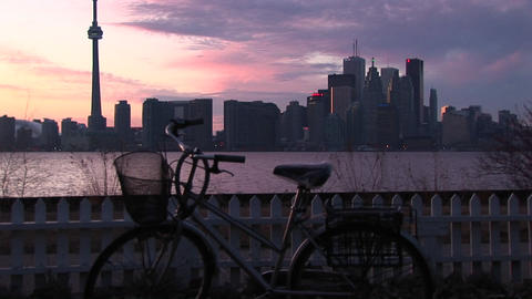 A tourist removes a bicycle parked on one of the Toronto... Stock Video Footage