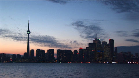 A spectacular view of the Toronto skyline at night, with lights, and a fading sunset Footage