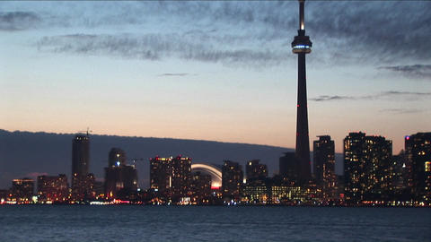 The camera pans back and forth from downtown Toronto to the CN-Tower and back for a creative perspec Footage