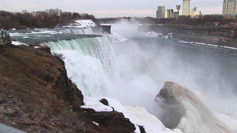 A longshot of Niagara Falls in winter with tourist hotels... Stock Video Footage