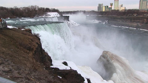 A longshot of Niagara Falls in winter with tourist hotels in the distance Footage