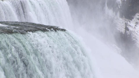 The camera pans from the edge of the Falls downward Stock Video Footage