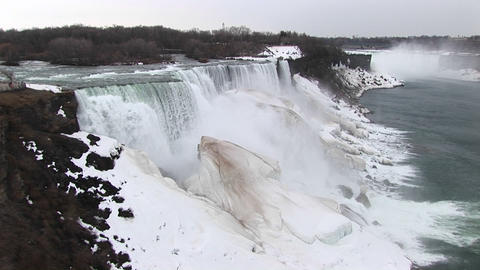 A look at Niagara Falls in winter with frozen mist... Stock Video Footage
