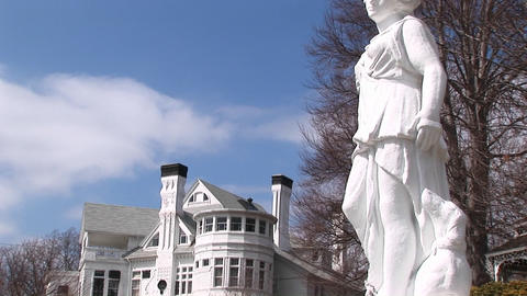 A Concrete Statue Stands Outside A Mansion stock footage
