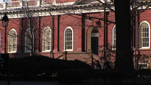 The camera focuses on a Harvard University building designed in colonial style of architecture Footage