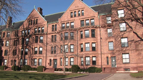 The camera pans across some of the buildings on Harvard's campus Footage