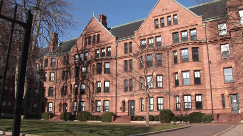 The camera pans across some of the buildings on Harvard's... Stock Video Footage