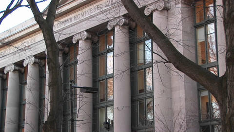 A pan up one of Harvard's law buildings, Langdell Hall Stock Video Footage