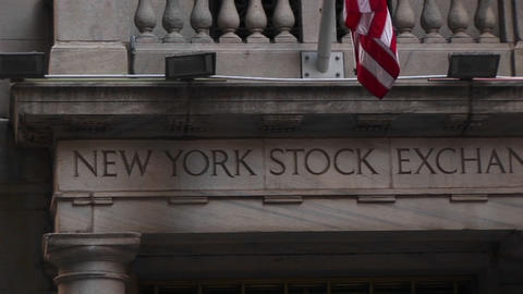 Pan across the New York stock exchange building Stock Video Footage