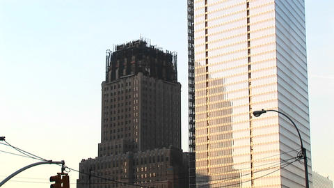 The camera pans up a new skyscraper under construction near Ground Zero in New York Footage
