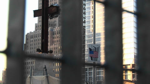 The camera pans up from street-level to show a cross made... Stock Video Footage