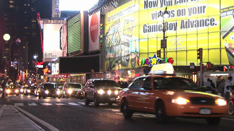 The streets are full of people after dark in this downtown shot of New York Footage