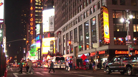 A busy downtown street with lights, pedestrians and... Stock Video Footage