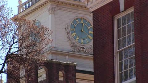 The camera pans up to the charming, ornate clock tower on Independence Hall Footage
