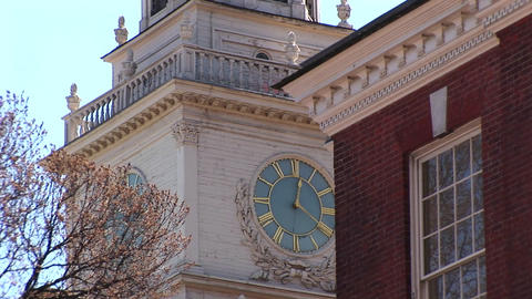 The camera pans up to the charming, ornate clock tower on... Stock Video Footage