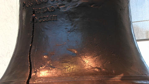 The camera pans from the bottom to the top of the Liberty Bell where we see part of the inscription Footage
