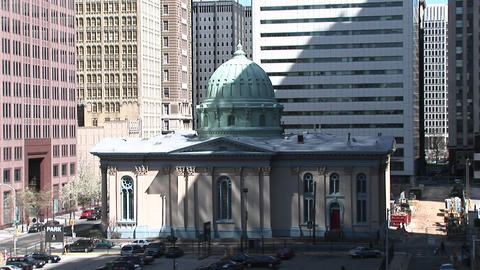 A charming domed building is dwarfed by the surrounding... Stock Video Footage