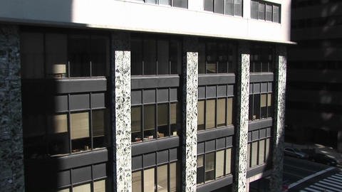 A zoom-in look at a rather boring office building exterior Footage