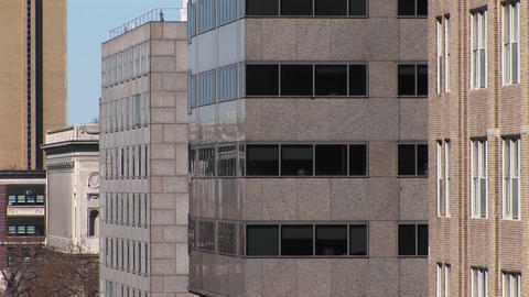 The camera zooms in on a dark, contemporary high-rise... Stock Video Footage