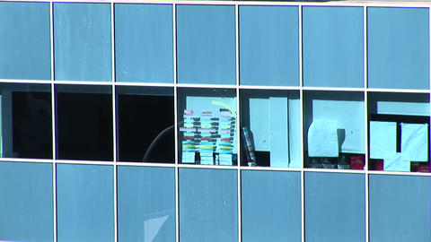 A blue, urban, office building has some of its windows... Stock Video Footage
