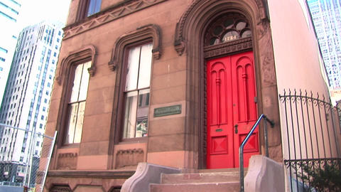Camera pans up a venerable old brownstone building now... Stock Video Footage