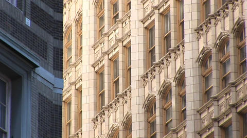 Zoom-in on the windows of a high-rise building Stock Video Footage