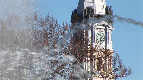 An artistic shot of the City Hall tower through fountain... Stock Video Footage
