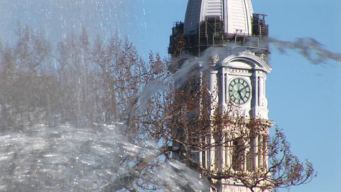 An artistic shot of the City Hall tower through fountain spray in Center City Philadelphia Footage