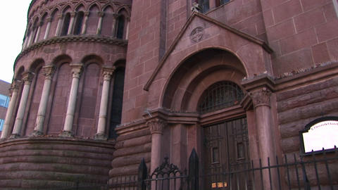 The camera pans up for a worms-eye view of the facade of... Stock Video Footage
