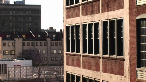 Medium-shot of the windows of a brick building Footage