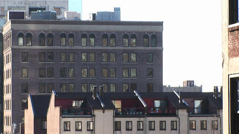The camera zooms in on a nondescript gray building with... Stock Video Footage
