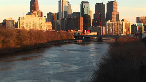 A pan up from the river during the golden-hour captures... Stock Video Footage