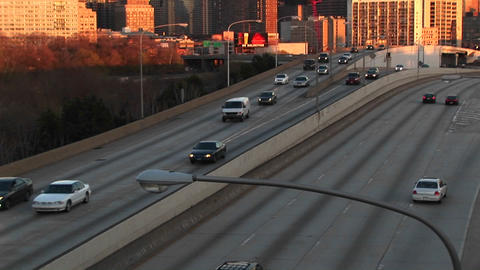 The camera pans up from a divided highway to Chicago's... Stock Video Footage