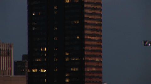 The camera pans up a skyscraper topped with a revolving... Stock Video Footage