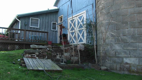 A sideview of modest home and barn-like door of the garage Stock Video Footage