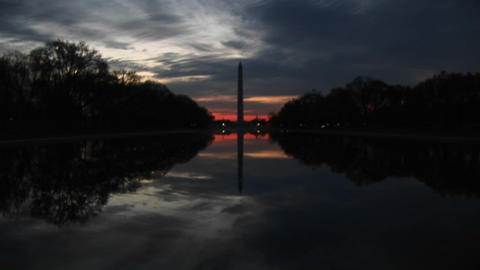 At golden-hour, nature creates a perfect mirror image of the Washington Monument and its environs Footage