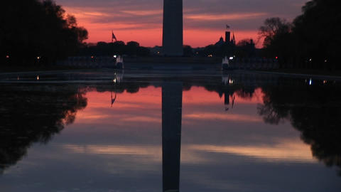 The camera pans up the reflection of Washington Monument... Stock Video Footage