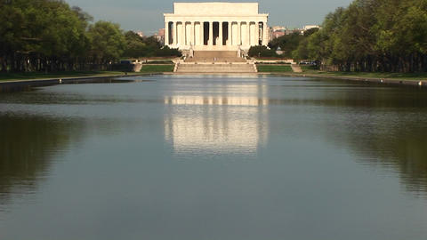 The camera pans up from a reflection to the actual Lincoln Memorial Footage