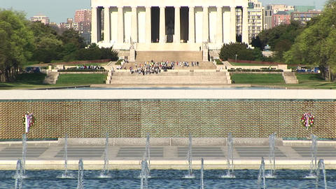 The camera pans from the fountains up to the Lincoln Monument in Washington, DC Footage