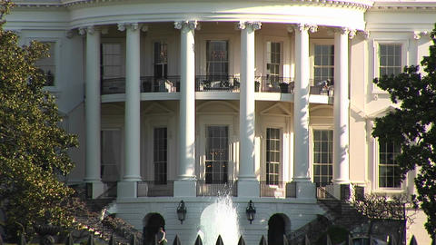 The camera slowly pans up the exterior of the White House in Washington DC Footage
