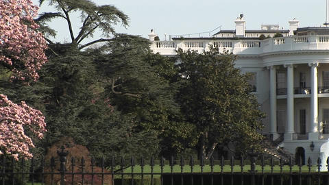 The camera pans-right from one side of the White House to... Stock Video Footage