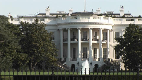 The camera pans-right from one side of the White House to the other Footage