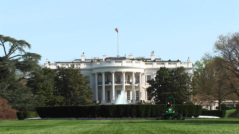 The camera zooms-in to the top of the White House Stock Video Footage