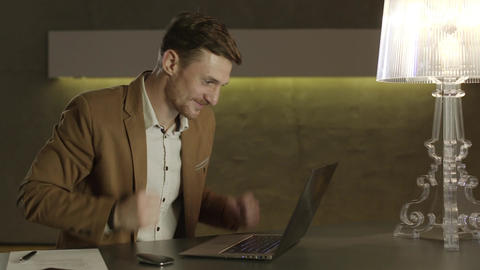 Businessman looking with joy at his laptop computer Footage