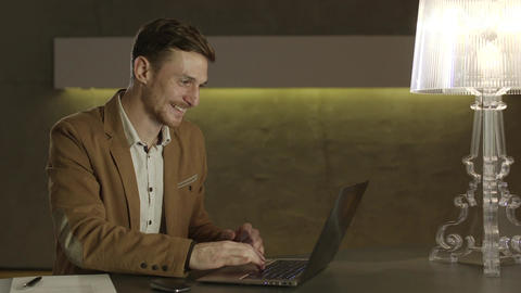 Businessman looking with happiness at his laptop computer Footage
