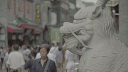 Architecture Of China. Dragon statue on the street Dashilan. Beijing Live Action